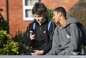 Teenage boys with a mobile phone